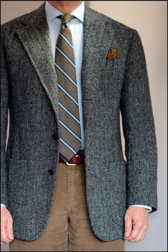 Business Casual with a sky twill shirt, striped tie, herringbone tweed sportcoat, and tan cords.