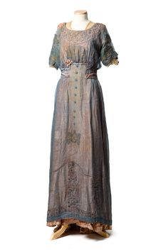 blue dress, c.1910s, has a blue chiffon overlay, covering an amazing underdress of pink velvet with corded cutwork, beading and lace insertion. The chiffon shimmered over the dress and this technique appears to have been very popular. It added mystery and delicacy to the garment. Though we do not know who wore this beautiful dress, it came to the Museum in 1940 from Mrs. D. R. Kirk of New York City.