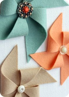 Felt pinwheel with button, earring or brooch would be a lovely replacement for a bow.