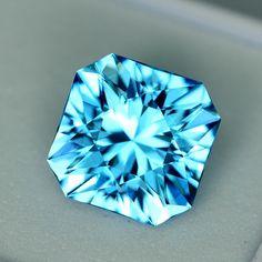 MJ3174 - 4.64ct electric blue Topaz - Brazil 9.46 x 6.73 mm clean, custom cut, irradiated, $125 including shipping
