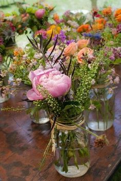 Jam jars and supermarket flowers are your best friends when it comes to bringing a big day in under budget. Pick up supermarket blooms the day before, and mix and match them for eclectic table toppers.