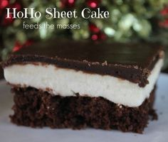 HoHo Sheet Cake. If youre looking for a decadent holiday cake that will feed the masses, the HoHo Sheet Cake Recipe will meet both of those requirements!