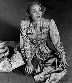 Lee Miller  Marlene Dietrich, wearing a coat by Schiaparelli, Paris, France, 1944  © Lee Miller Archives, England 2006. All rights reserved.