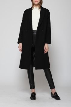 Black double breasted wool coat. Classic, loose and boxy trench style. Fully lined. Hemline hits mid calf.   Double Breasted Coat by Goldie. Clothing - Jackets, Coats & Blazers - Coats Clothing - Jackets, Coats & Blazers Canada