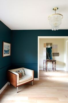 "This would be amazing for the basement! Site says its ""Benjamin Moore Dark Harbor Paint mixed 25% darker.""  Previous pinner said: tried River Blue (very similar) and it's too dark for my small space.  Galapagos Turquoise is the next lightest shade on the swatch card. [the white trim and light floor make it awesome]"