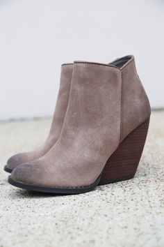 """- Suede leather upper with shapely almond toe - Side zipper closure - Rubber sole - 3-1/2"""" wedge heel - Khaki in color."""