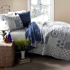 Refresh your master suite or guest room with this lovely cotton quilt set, showcasing a patchwork motif for eye-catching appeal.  Pr...