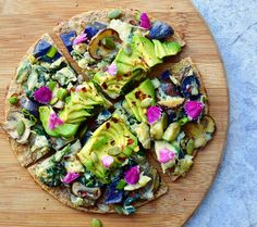 Breakfast Pizza- sprouted pizza flat, melte, raw cheater cheese, egg scramble, Avo, & chili flakes. For the scrambleI sauté 1/4 cup chopped purple potato, 1/4 cup chopped zucchini, 3 sliced crimini mushrooms, & 1 cup of spinach in 1 tbsp avocado oil. Season with salt and pepper, add 2 eggs, whisked . Scrambled on low heat for a few mins! Kay Carrera🌿 (@kayscleaneats)