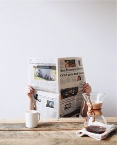 Good coffee & a real newspaper.. just what I like to do in the morning, on the deck outside.: