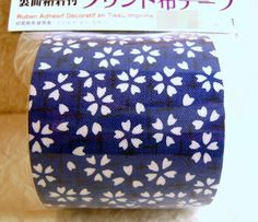 This is really cool Japanese style fabric tape. It is 100% cotton fabric tape on a roll. The pattern is sakura cherry blossoms. Colors-dark blue and white.    It measures 5 x 100 cm or 1.96 x 39.3 inches. Just cut, peel off the paper and press down.    *At the last photo, You can use it to decorate Air Jacket Case for iPhone as Japanese Style Case.    This would be perfect for so many projects-scrapbooking, card making, covering boxes or any project you can think of!