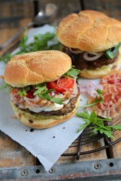 Enjoy all the flavors of Italy in this epic Tuscano Burger – packed with fresh shallots, crisp pancetta, arugula, pesto aioli, and drizzled with balsamic vinegar!