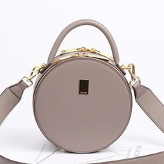 Overview: Design: Leather Circle Bag Circle Purse Crossbody Bag Round Bag Round Purse In Stock: 3-5 Days To Process Orders Include: A Handbag With Two Straps Material: Italian Cowhide Measures: L 19cm ×W 8cm × H 19cm Weight:  0.68kg Shipping: $19 The Post For 7-14 Days Delivered Slots: 1 mainslot, 1 inner slot Crossbody Shoulder Bag, Leather Crossbody Bag, Leather Purses, Leather Shoulder Bag, Circle Purse, T Bag, Round Bag, Cross Body Handbags, Mini Bag