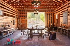 One of the barns meant for entertaining family and friends is also kitted out with building blocks and ride-on toys.