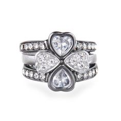 Stackable Heart Clover Ring  $45.00 / Item # R004  Set of three stackable heart bands that form a clover shape when worn together. Two bands are in shiny hematite with a heart shaped crystal center and pave band; one band is in silver with two heart shaped crystals. Available in size 7.5.