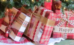 Lots of different holiday ribbons, plaid theme for my StoryBook Christmas - My Paddington Bear Tree - santa ornament as a gift tag, and tea stained white boxes for the vintage feel
