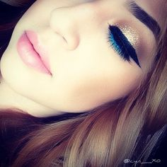 The gold glittery eyes with black wing eyeliner, red lips, and GREEN on bottom lash line would be perf for Xmas!!