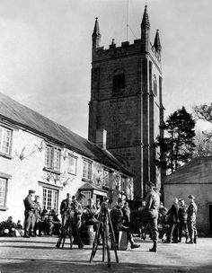 """The 400 year old antique Royal Oak Inn, nestling under the rustic shadow of the village church in Pillaton, was the place of parade for the last """"Fallin' of the Pillaton G Platoon"""" Number 2 Company Home Guard formed exclusively of farmers. The Guards are pictured having a drink and chat before breaking up after they """"fell out""""."""