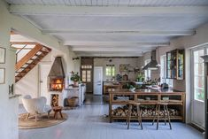 A vintage-looking DeVOL Haberdasher kitchen with fireplace in a Swedish countryside Cottage - The Nordroom #cottage #cottagekitchen #vintagedesign #vintagehome #devolkitchen #woodenkitchen Swedish Kitchen, Swedish Cottage, Old Cottage, Wooden Kitchen, Kitchen Interior, Interior And Exterior, Kitchen Decor, Interior Design, Kitchen Shelves