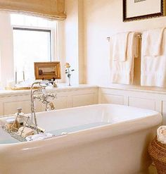 Big Tub  --- love that tub caddy... and pretty vintage faucet fixtures