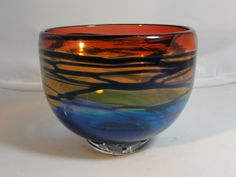 Looking for something for Valentines day...I have purchased something from this glass artist...Transparent Red, Gold, and Blue Glass Bowl