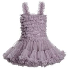 Beautiful pale dusky mauve dress by English company Angel's Face, made from soft, delicate tulle net with heavenly layers of ruffles, perfect for all little angels. With just the right amount of frou-frou to be fabulous, the body is elasticated between the layers of frillto make it flexible for growth and easy to pull on and the skirt is very full and ideal for swishing. The dressis stored in a branded vintage style box which makes a great gift.