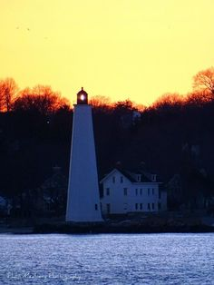 New London Harbor Light at sunset from Avery Point Groton 3-12-15