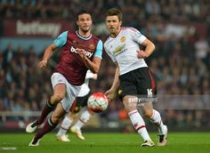 West Ham United's English striker Andy Carroll (L) vies with Manchester United's English midfielder Michael Carrick during the English Premier League football match between West Ham United and Manchester United at The Boleyn Ground in Upton Park, in east London on May 10, 2016. / AFP / GLYN KIRK / RESTRICTED TO EDITORIAL USE. No use with unauthorized audio, video, data, fixture lists, club/league logos or 'live' services. Online in-match use limited to 75 images, no video emulation. No use…