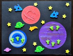 I Heart Crafty Things: Toddler Craft- Outer Space Craft using cupcake liner planets and glow-in-the-dark space foam stickers. Book recommendation is in the blog post.