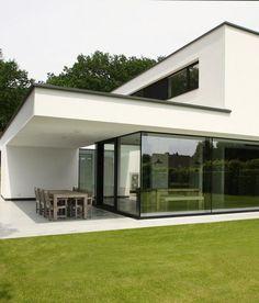 Betonbouw: grijs, maar allesbehalve saai! • Foto: www.concretehouse.be • nieuwbouw • modern • gevelpleister