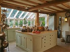 Hang pots and pans off a beam like this down the center of the kitchen??