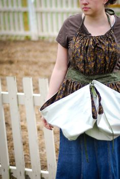 Tutorial: Gathering Apron - from On Just A Couple Acres - On this one, you can fold up and tie the bottom of the apron, and use it to hold all the fruits and vegetables as you gather them from the garden.
