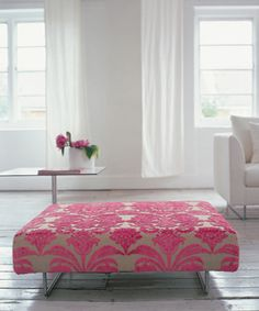 Great pink ottoman. This would go great with my fushia wall.