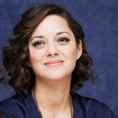 Soft: For touchable waves, Vetica created a side part, curled Cotillard's hair away from the face with a 1-inch curling iron, then brushed through the curls with his fingers to relax them.