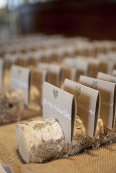 DIY Birch Bark Display for Escort Cards | See the wedding on SMP: http://www.StyleMePretty.com/2014/01/30/elegant-lakeside-wedding-at-mills-falls/ Kate Preftakes Photography