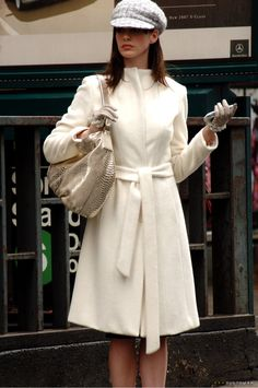 white coats. with matching accessories.    anne hathaway in the devil wears prada movie