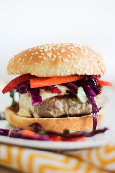 Thai Turkey Burgers with Curry Yogurt Sauce and Asian Cabbage Slaw | http://www.theroastedroot.net