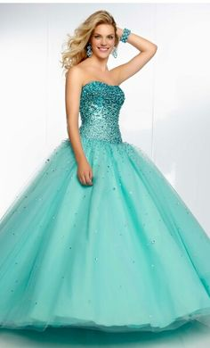 Pretty turquoise grad dress I love the top it's so sparkly