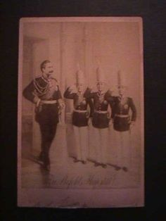 This is an old image done probably in 1900 of the Kaiser entering the Potsdam Palace and being greeted by three of his sons (the Royal Princes). They are dressed in the uniform of the Guard Grenadier Regiment with the tall miters that were the mark of this elite group
