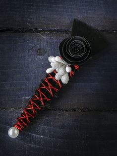 "An elegant boutonniere in red and black is made of wire in red color, paper flowers, artificial white berries, with black feather and pearl. Length is 4.3 ""(11 cm). It comes with a base for brooch. You can find me at:https://www.etsy.com/shop/LapelDesign"