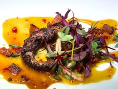 Charred Octopus Salad with Tangerine Sauce recipe from Bobby Flay via Food Network