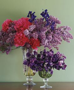 Lilacs, Siberian Iris, Peonies, Sweet Peas: An abundance of fragrant blooms fills a pair of shapely vases. The exuberance of the large bouquet comes from the way its brilliant colors splash against one another, just as they might in the garden. For longer life, cut lilacs from the bush just as the flowers begin to open. Sweet peas make an impact on their own in the smaller vase.