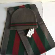 "Gucci Hat And Scarf Set with Tags And Box 🔥 CONDITION New With Tags This item has original tags and shows no visible signs of wear. 🍀 DESCRIPTION Gucci hat and scarf set, new with tags and a gift box. Hat Sz XL. Material: 70% wool, 30% silk. Scarf length -70"", width 10"". Grey color with green-red-green stripes. Comes in a Gucci gift box. ✨ PRIORITY MAIL SHIPPING IS INCLUDED IN THE PRICE. IF YOU NEED OVERNIGHT SHIPPING, PLEASE CONTACT ME BEFORE PURCHASE. Gucci Accessories Hats"