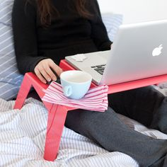 cute tray for laptop on couch or in bed... I love my lap desk, but my laptop always slides off, I need this!