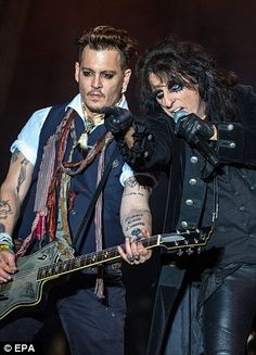 US actor and musician Johnny Depp (L) and US singer Alice Cooper (R) of the band Hollywood Vampires perform during their concert at the 'Hessentag' (Hessian Day) festival in Herborn, Germany, 29 May 2016