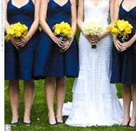 Yellow bouquets with navy and white ribbon
