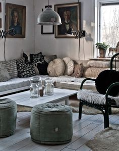 Corner daybeds and a fantastic industrial light.
