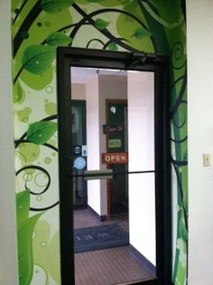 Our lobby door just got framed with this wild wallpaper design. Custom graphics and easy installation makes this a fun, creative way to express our brand and inspire customers who stop by the sign studio. 763-432-7630