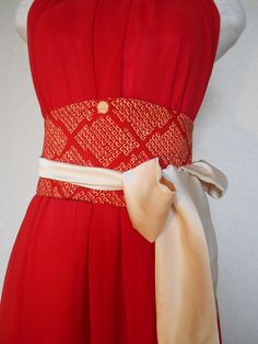 Cinch your waist and add elegance with this stunning reversible obi belt.