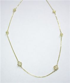 Diamond Station Necklace - The necklace features alternating stations of double sided diamond stations. The diamonds weigh a total of 0.23ct and the necklace is made in 14kt yellow gold. K506022 (subject to prior sale) – Lilliane's Jewelry – 4101 W. 83rd St. Prairie Village, KS 66208 – 913-383-3376 –
