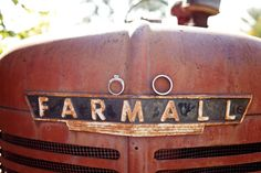 I adored the old Farmall Tractor for ANDREA + TRENT | Bennington, Nebraska Farm Wedding Using it for the ring shot just made perfect sense.  I love the surroundings.  Old Barns make for the best backdrops!